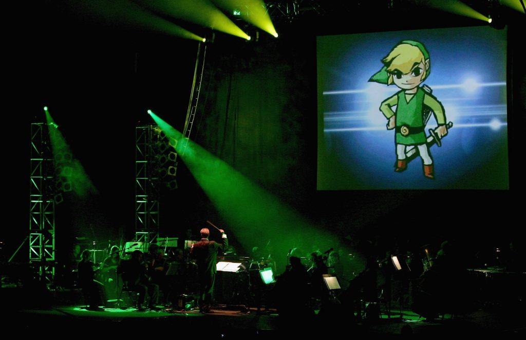 LONDON - NOVEMBER 25: Music from the video game Zelda is performed during 'Video Games Live' by the English National Ballet Orchestra and the Apollo Voice Choir at the Hammersmith Apollo on November 25, 2006 in London, England. The performance combines strobe lighting and a big screen backdrop with a musical interpretation of well known video games. (Photo by Gareth Cattermole/Getty Images)
